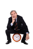 Man sitting on clock Royalty Free Stock Image