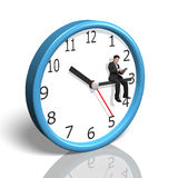 Businessman sitting on clock hand Royalty Free Stock Photography