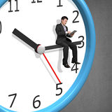 Businessman sitting on clock pointer Royalty Free Stock Photo