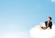 Businessman sitting on cloud with copy space Royalty Free Stock Image