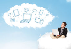 Businessman sitting in cloud with laptop Stock Photos