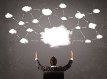 Businessman sitting with cloud technology above his head royalty free stock images