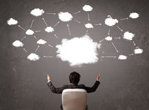 Businessman sitting with cloud technology above his head Royalty Free Stock Image