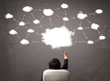 Businessman sitting with cloud technology above his head Royalty Free Stock Photography