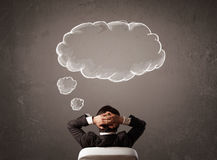 Businessman sitting with cloud thought above his head royalty free stock images