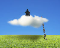 Businessman sitting on cloud with wooden ladder, meadow and sky. Businessman sitting on cloud with wooden ladder, green meadow and blue sky Royalty Free Stock Photography