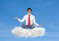 Businessman sitting on cloud Royalty Free Stock Image