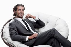 Businessman sitting in a comfortable big chair. Closeup.businessman sitting in a comfortable big chair Royalty Free Stock Images