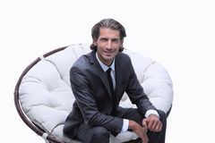 Businessman sitting in a comfortable big chair. Closeup.businessman sitting in a comfortable big chair Royalty Free Stock Photo