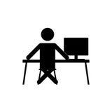 Businessman sitting at the computer Stock Photos