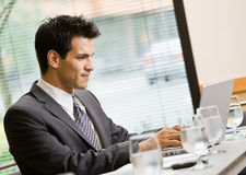 Businessman sitting in conference room Royalty Free Stock Photo