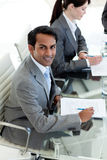 Businessman sitting at a conference table Royalty Free Stock Image