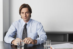 Businessman Sitting At Conference Table Stock Photography