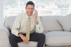 Businessman sitting on the couch Stock Photography