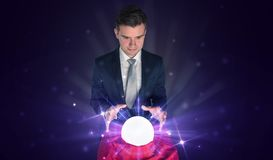 Businessman sitting with crystal ball in action royalty free stock photos