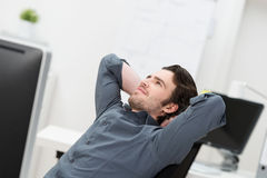 Businessman sitting daydreaming Royalty Free Stock Photos