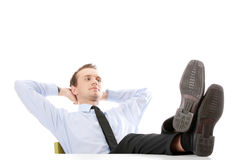 Businessman sitting at desk. Isolated Stock Photo