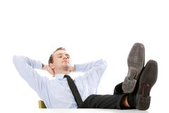 Businessman sitting at desk. Isolated Stock Image