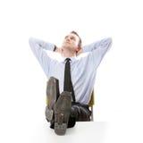 Businessman sitting at desk Stock Image