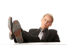 Businessman sitting at desk,. Isolated Royalty Free Stock Photo