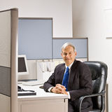 Businessman sitting at desk Royalty Free Stock Photography
