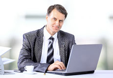 Businessman sitting at desk Royalty Free Stock Photo