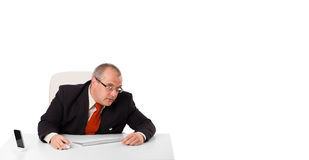 Businessman sitting at desk with copy space Royalty Free Stock Images
