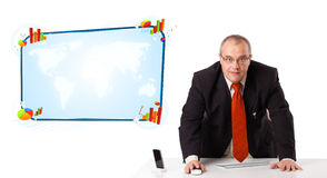 Businessman sitting at desk with copy space Stock Image