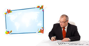 Businessman sitting at desk with copy space Royalty Free Stock Photo