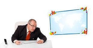 Businessman sitting at desk with copy space Stock Photo