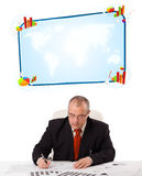 Businessman sitting at desk with copy space Stock Images