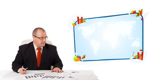Businessman sitting at desk with copy space Royalty Free Stock Photos