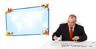 Businessman sitting at desk with copy space Royalty Free Stock Image