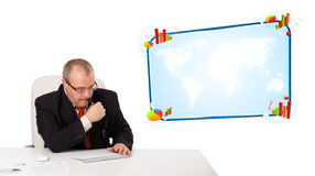 Businessman sitting at desk with copy space Stock Photography