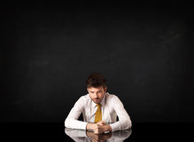 Businessman sitting at a desk Stock Images