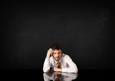 Businessman sitting at a desk Royalty Free Stock Images