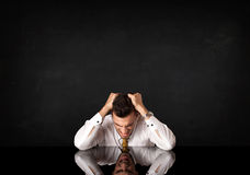 Businessman sitting at a desk Stock Image