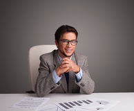 Businessman sitting at desk and doing paperwork Royalty Free Stock Images