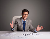 Businessman sitting at desk and doing paperwork Royalty Free Stock Image