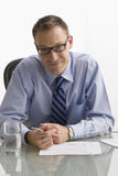 Businessman Sitting at Desk - Isolated Royalty Free Stock Photography