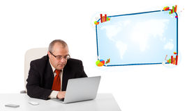 Businessman sitting at desk and looking the laptop with copy spa Stock Photography