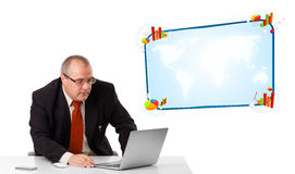 Businessman sitting at desk and looking the laptop with copy spa Stock Photos
