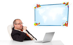 Businessman sitting at desk and looking the laptop with copy spa Stock Images
