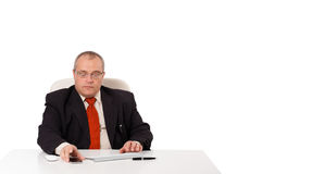Businessman sitting at desk and looking mobilephone with copyspa Royalty Free Stock Photos