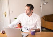 Businessman sitting at desk Royalty Free Stock Images