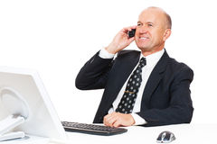 Businessman sitting at desk in office Stock Photography