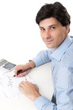 Businessman sitting at desk in office Stock Photos