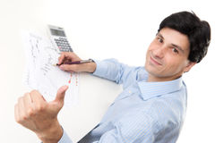 Businessman sitting at desk Stock Photo