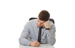 Businessman sitting by a desk in the office. Royalty Free Stock Photo