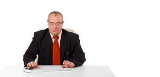 Businessman sitting at desk and typing on keyboard with copy sca Stock Photos